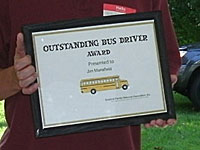 Steve Botsford Presents Jim Mansfield with Honorary Bus Driver Award, July 2011